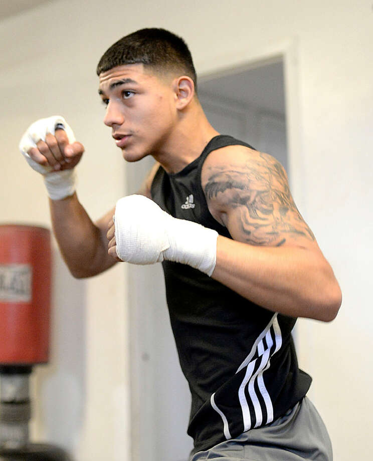 Michael Dutchover, a senior at Midland High, photographed while training Thursday, March 17, 2016, at the Clayton Williams Boxing Center. Dutchover won the Texas Golden Gloves boxing title in the 132-pound division. James Durbin/Reporter-Telegram.