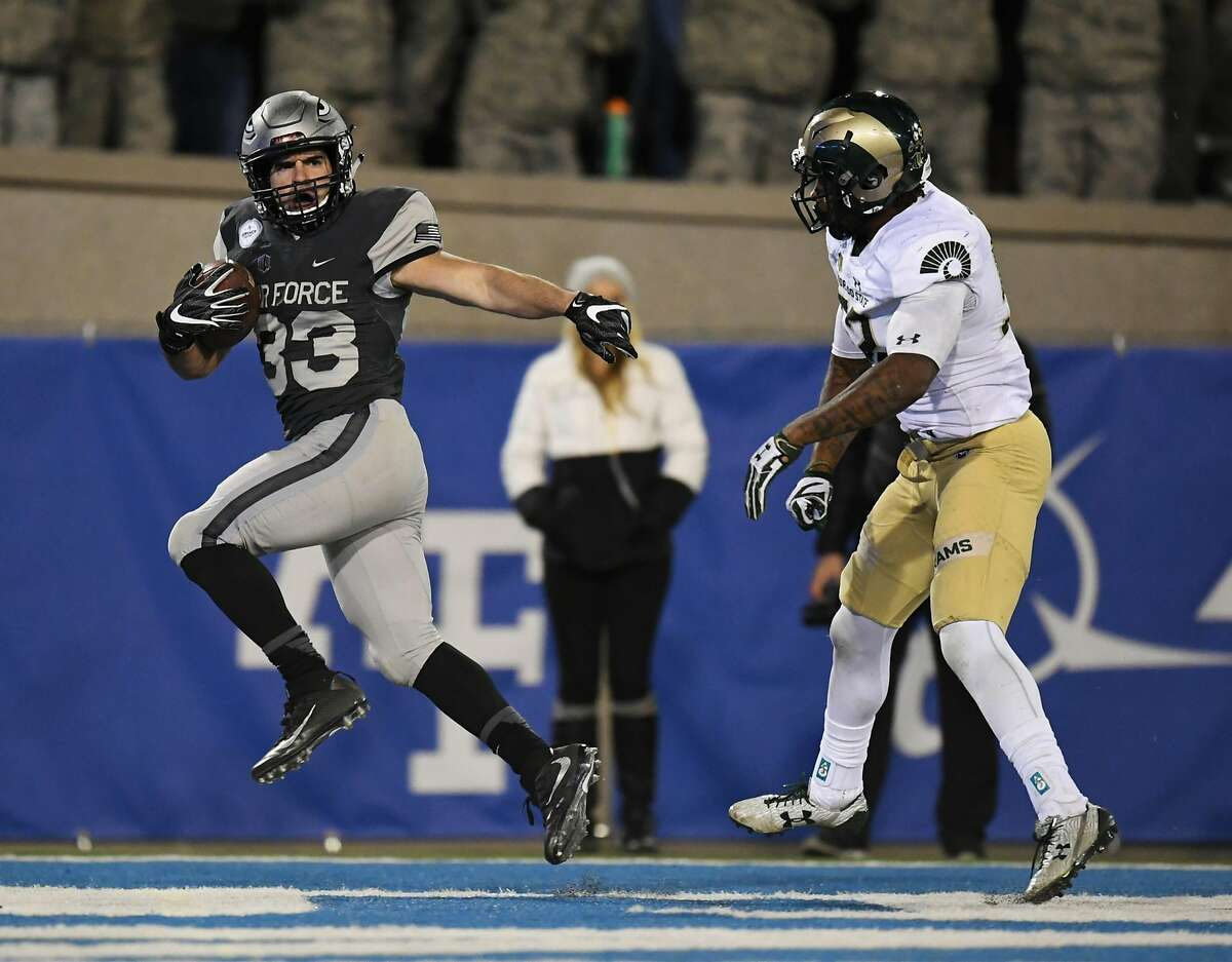 Air Force running back Tim McVey gets into the end zone past Colorado State linebacker Tre Thomas, right, on a touchdown during the second quarter of an NCAA college football game Saturday, Nov. 12, 2016, in Colorado Springs, Colo. (Mark Reis/The Gazette via AP)