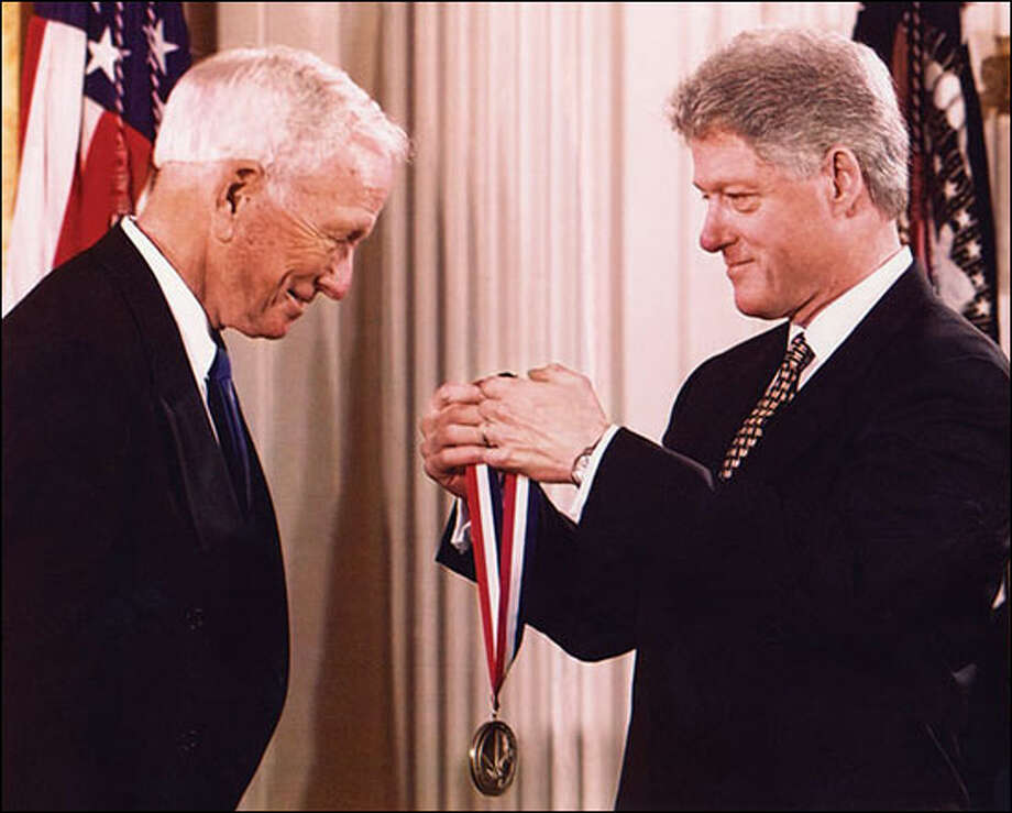 President Bill Clinton awarding Dr. Denton A. Cooley with the National Medal of Technology in 1998. Photo: Courtesy Of Texas Children's Hospital