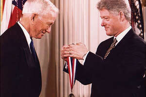 President Bill Clinton awarding Dr. Denton A. Cooley with the National Medal of Technology in 1998.