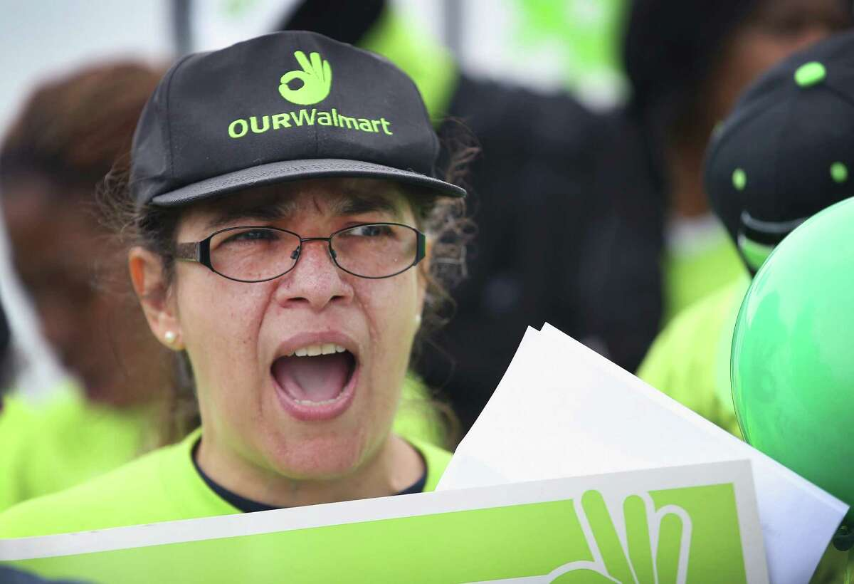 CORRECTED VERSION: CHICAGO, IL - JUNE 04: Linda Haluska, who has worked for Wal-Mart for more than eight years, joins other Wal-Mart workers and union activists in a protest outside a Wal-Mart store on June 4, 2014 in Chicago, Illinois. Workers and activists were scheduled to hold strikes at Wal-Mart stores in more than 20 cities today in their campaign to raise wages. The strikes are scheduled to draw attention to worker grievances before Wal-Marts annual shareholder meeting which takes place June 6 in Fayetteville, Arkansas. (Photo by Scott Olson/Getty Images)