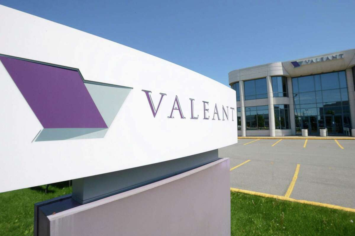 FILE - This May 27, 2013, file photo, shows the head office and logo of Valeant Pharmaceuticals in Laval, Quebec, Canada. Federal prosecutors have charged former executives of Valeant Pharmaceuticals and a mail-order pharmacy it helped establish, Philidor, with wire fraud and conspiracy in an alleged scheme to bilk Valeant out of tens of millions of dollars. The U.S. AttorneyÂ?'s office in Manhattan has filed the charges against ex-Valeant executive Gary Tanner and Andrew Davenport, who ran the now-defunct Philidor. (Ryan Remiorz/The Canadian Press via AP, File)