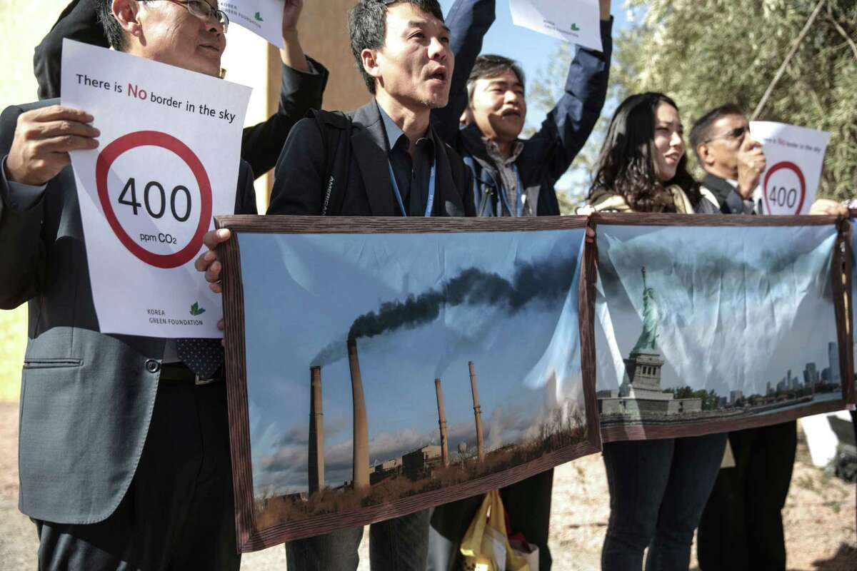 Activists stage a protest against man-made emissions of carbon dioxide and other global warming gases, at the COP22 climate change conference in Marrakech, Wednesday, Nov 16, 2016. (AP Photo/Mosa'ab Elshamy)