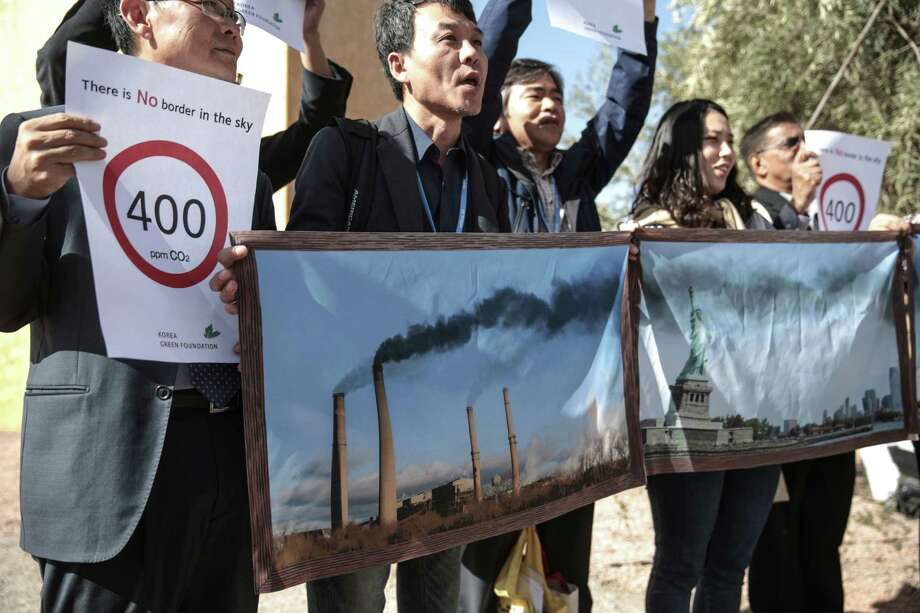 Activists stage a protest against man-made emissions of carbon dioxide and other global warming gases, at the COP22 climate change conference in Marrakech, Wednesday, Nov 16, 2016. (AP Photo/Mosa'ab Elshamy) Photo: Mosa'ab Elshamy, STF / Copyright 2016 The Associated Press. All rights reserved.
