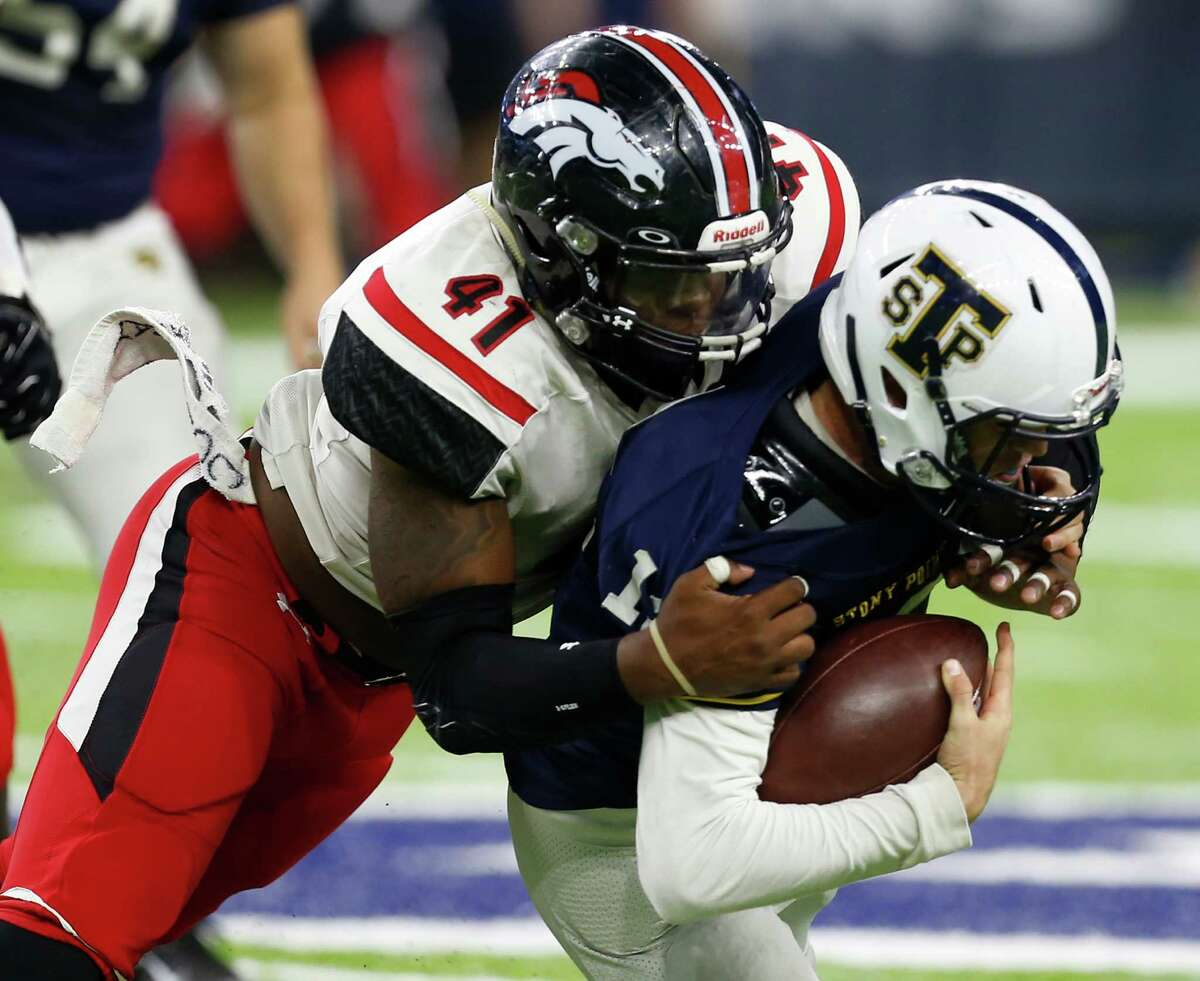 Westfield linebacker Joshua Brown (41) sacks Round Rock Stony Point quarterback Jack Driskill (12) during the third quarter of a Class 6A, Division II, high school football playoff game at NRG Stadium on Thursday, Nov. 17, 2016, in Houston.