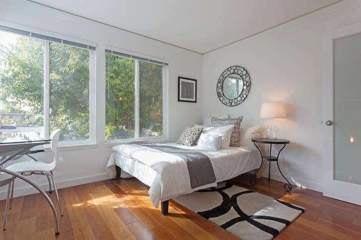 Hardwood flooring graces the interior of the two bedroom Oakland condo.
