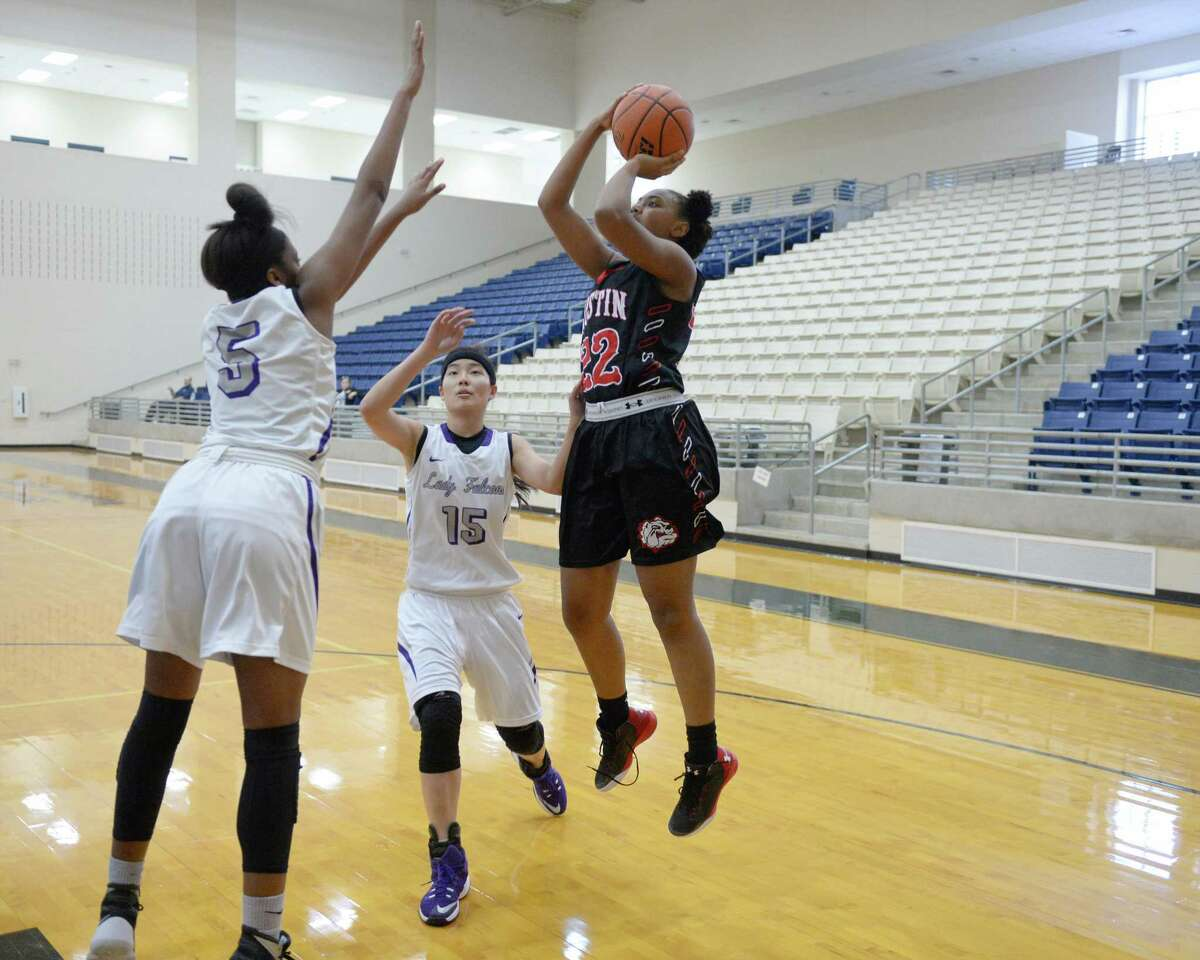 Jalynn Johnson (22) of Austin takes a jump shot during the first half of a basketball game between the Ft. Bend Austin Bulldogs and the Jersey Village Falcons during the Ft. Bend ISD Varsity Girls Tournament on Thursday November 17, 2016 at the Buddy Hopson Field House, Missouri City, TX.