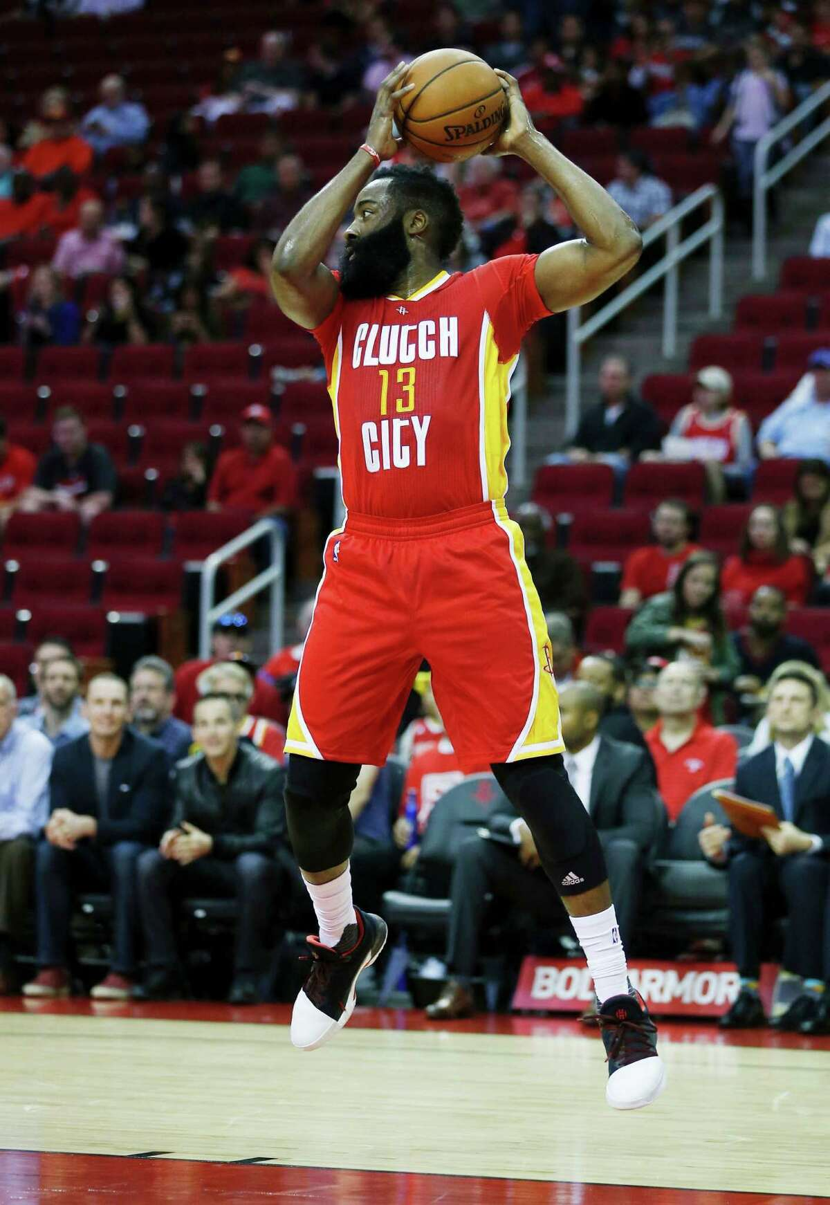 Houston Rockets guard James Harden (13) grabs a rebound against the Portland Trail Blazers in the first half of an NBA basketball game on Thursday, Nov. 17, 2016, in Houston. (AP Photo/Bob Levey)