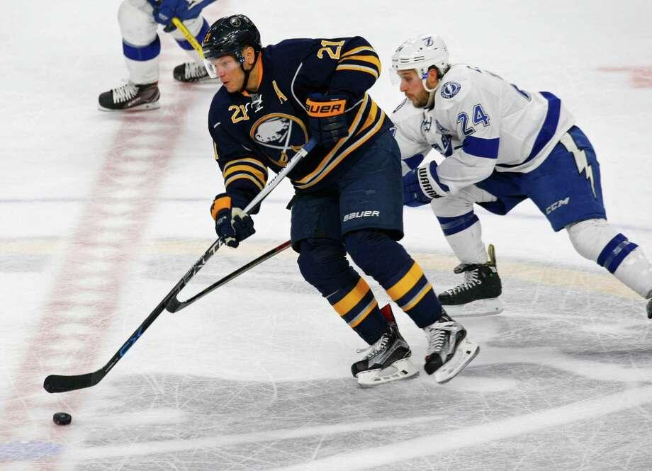 Buffalo Sabres forward Kyle Okposo (21) skates past Tampa Bay Lightning forward Ryan Callahan (24) during the second period of an NHL hockey game, Thursday, Nov. 17, 2016, in Buffalo, N.Y. (AP Photo/Jeffrey T. Barnes) ORG XMIT: NYJB110 Photo: Jeffrey T. Barnes / 2016
