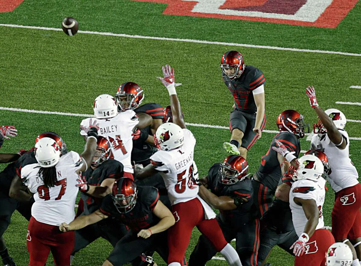 University of Houston place kicker Ty Cummings kicks a field goal during the second half of college football game action against the Louisville Cardinals at TDECU Stadium Nov. 17, 2016, in Houston.