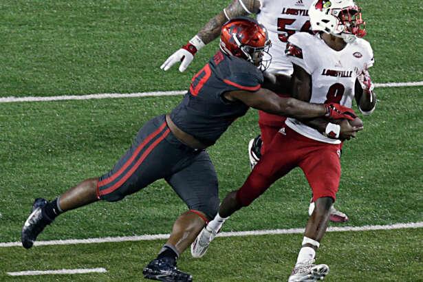 University of Houston defensive tackle Ed Oliver left, sacks Louisville Cardinals quarterback Lamar Jackson during the second half of college football game action at TDECU Stadium Nov. 17, 2016, in Houston.