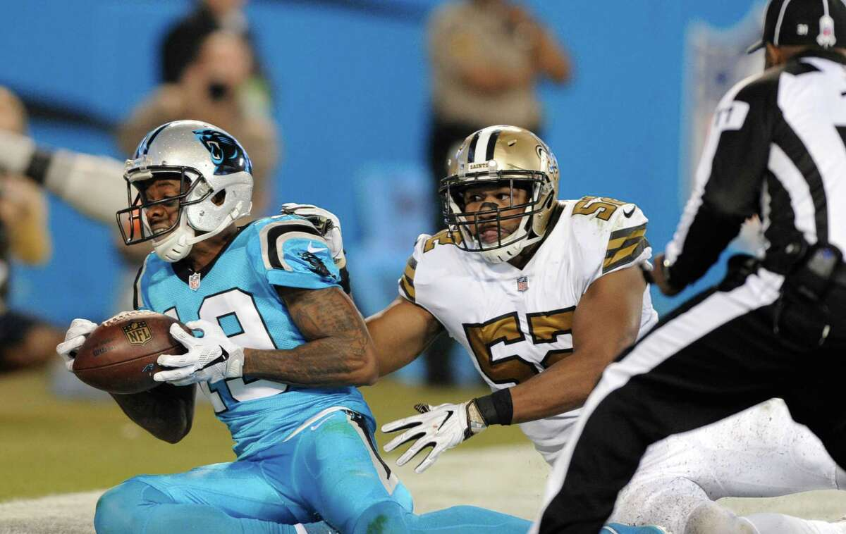 Carolina Panthers' Ted Ginn (19) catches a touchdown pass as New Orleans Saints' Craig Robertson (52) defends in the first half of an NFL football game in Charlotte, N.C., Thursday, Nov. 17, 2016.