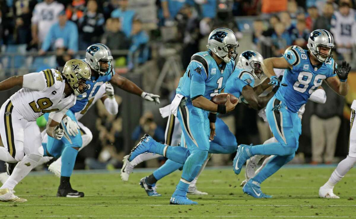 Carolina Panthers' Cam Newton (1) scrambles against the New Orleans Saints in the first half of an NFL football game in Charlotte, N.C., Thursday, Nov. 17, 2016.