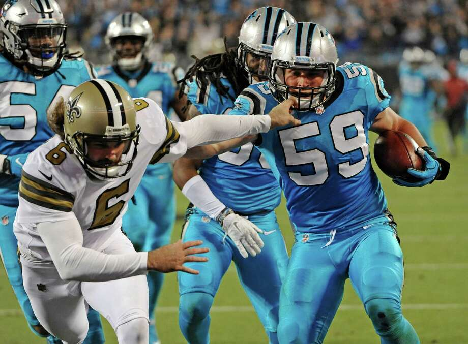 Carolina Panthers' Luke Kuechly (59) runs past New Orleans Saints' Thomas Morstead (6) as he returns a blocked field goal attempt in the first half of an NFL football game in Charlotte, N.C., Thursday, Nov. 17, 2016. (AP Photo/Mike McCarn) ORG XMIT: NCCB113 Photo: Mike McCarn / FR34342 AP