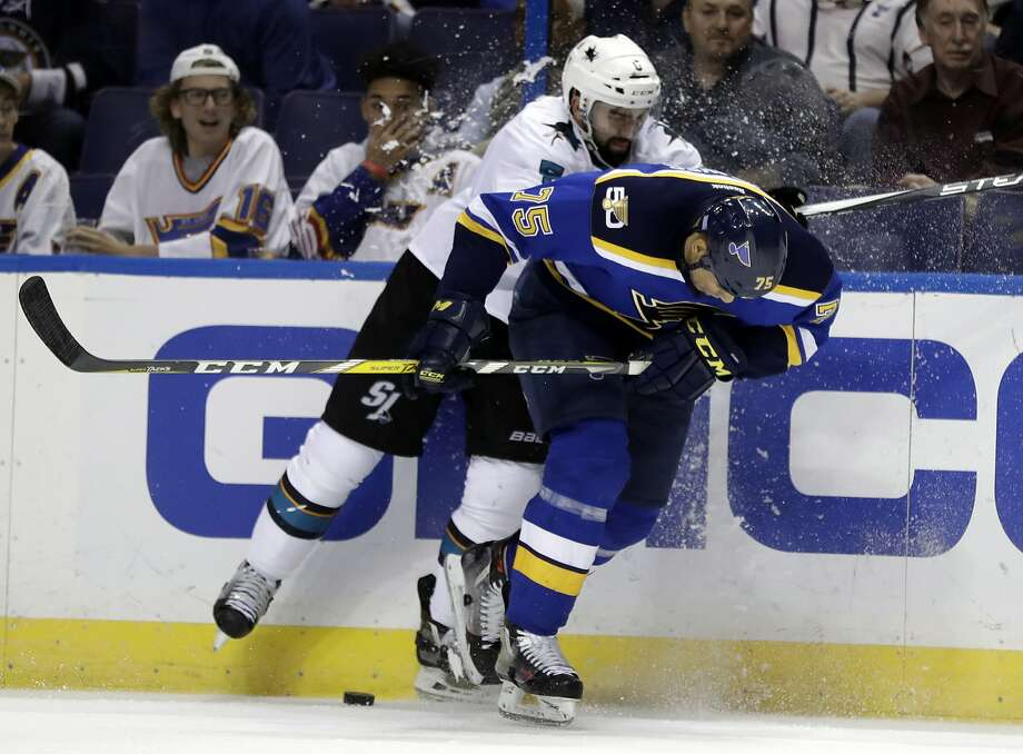 The Sharks' David Schlemko tries to knock Blues right wing Ryan Reaves off the puck during the third period. Photo: Jeff Roberson, Associated Press