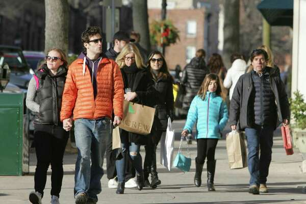 Shoppers stroll down Greenwich Avenue during the last weekend of holiday shopping in Greenwich, Conn. on Dec. 20, 2015.
