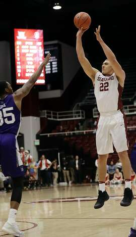 Stanford forward Reid Travis (22) shoots against Weber State's Kyndahl Hill during the second half of an NCAA college basketball game Thursday, Nov. 17, 2016, in Stanford, Calif. (AP Photo/Marcio Jose Sanchez)