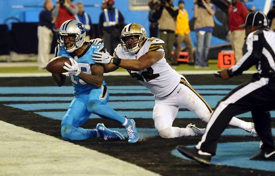 Carolina's Ted Ginn Jr. hauls in a 40-yard touchdown pass in the win. Photo: David T. Foster III, TNS
