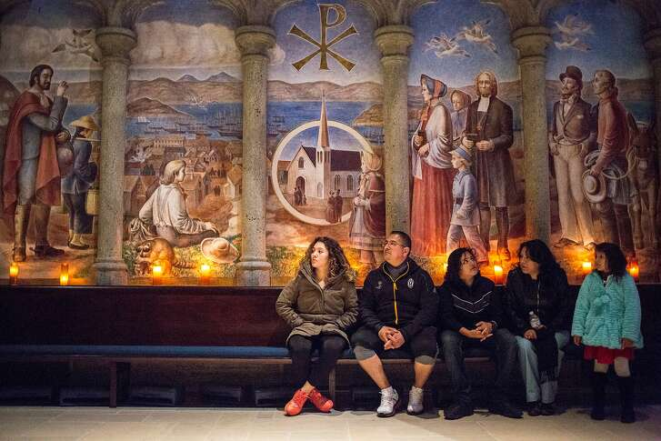 From left: Dayana, age 22; her father Miguel; her brother Joshua, age 14; mother Veronica; and sister Luana, age 6; listen in to church service at Grace Cathedral on Thursday, Nov. 17, 2016 in San Francisco, Calif.