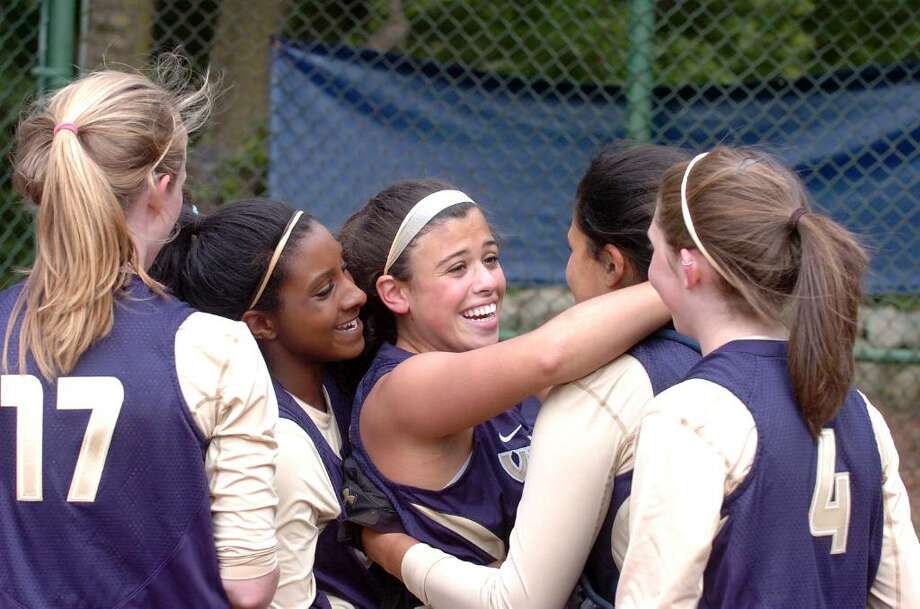 King pitcher Kaitlyn DellaJacona celebrates with teammates after winning the FAA final as King hosts Holy Child in softball game Wednesday afternoon, May 19, 2010. King won the title. Photo: Keelin Daly / Stamford Advocate