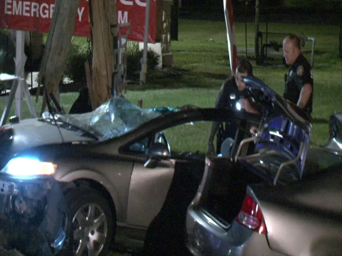 Harris County Sheriff's deputies are seen at the site of a vehicle wreck along Spring-Cypress Road in Spring, Texas around 12:15 a.m. on Nov. 18, 2016. The driver of the vehicle died after she struck a pole, splitting her vehicle in half.