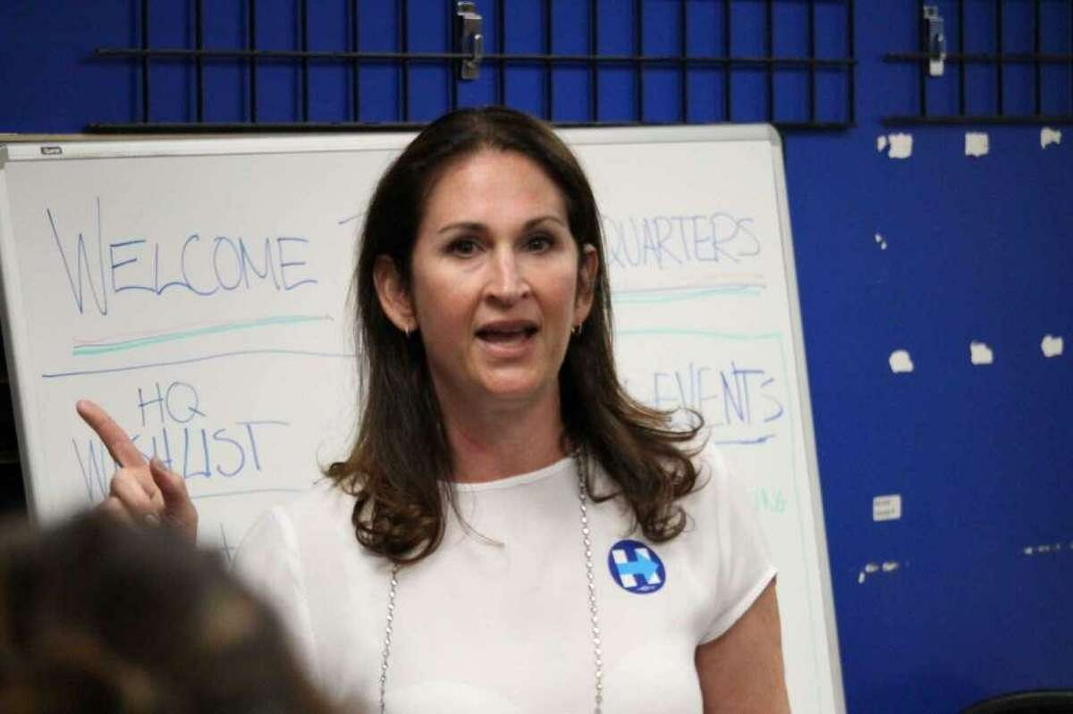 Westport Democratic Town Committee Chairwoman Melissa Kane speaks to Democrats at DTC headquarters.