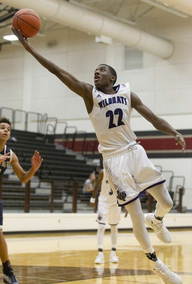 Willis' Darius Mickens (22) makes a layup during the fourth quarter of a non-district high school basketball game at the New Caney ISD Tournament Thursday, Nov. 17, 2016, in Porter. San Antonio O'Conner defeated Willis 67-55. Photo: Jason Fochtman/Houston Chronicle