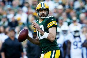 GREEN BAY, WI - NOVEMBER 06:  Aaron Rodgers #12 of the Green Bay Packers drops back to pass in the first quarter against the Indianapolis Colts at Lambeau Field on November 6, 2016 in Green Bay, Wisconsin. (Photo by Dylan Buell/Getty Images)