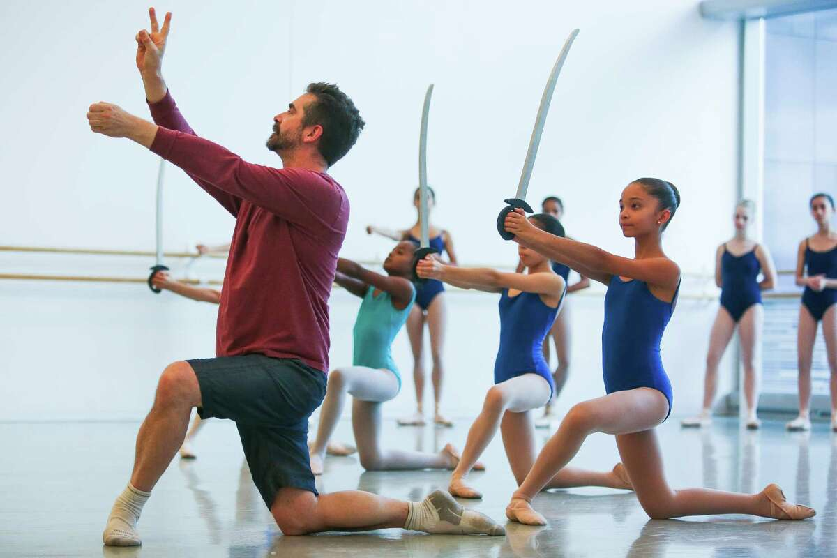 Top, dancers go en pointe as toy soldiers during a rehearsal of the battle scene.