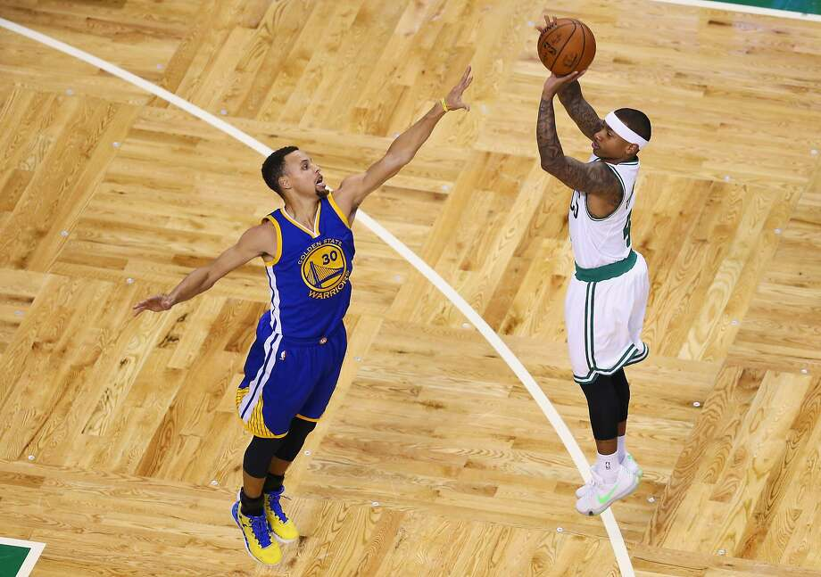 BOSTON, MA - DECEMBER 11:  Isaiah Thomas #4 of the Boston Celtics takes a shot over Stephen Curry #30 of the Golden State Warriors during the first quarter at TD Garden on December 11, 2015 in Boston, Massachusetts.  (Photo by Maddie Meyer/Getty Images) Photo: Maddie Meyer, Getty Images