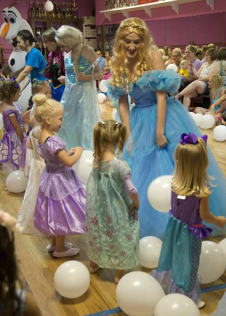 Girls dance with Frozen characters at the Fairy Tale Princess Dance Camp at Dee-Ann Studio of Dance. Photo: Tim Fischer