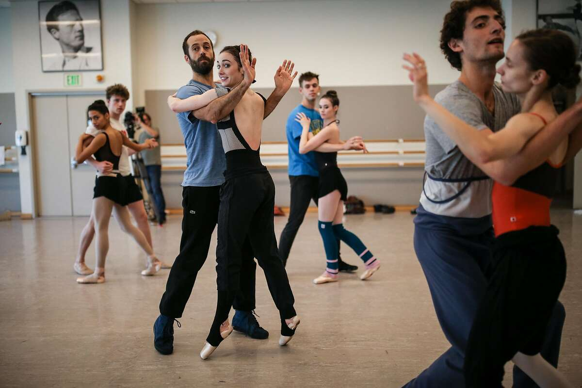 Benjamin Millepied (center left) runs through part of the choreography with dancers during rehearsal at the SF Ballet studio on Thursday, November 18, 2016 in San Francisco, Calif.