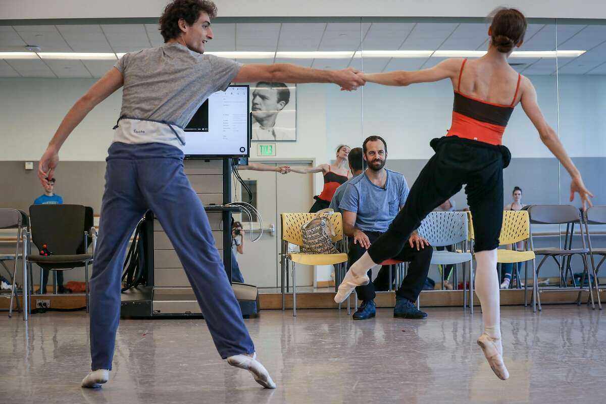 Benjamin Millepied (center) watches along as Carlo Di Lanno and Maria Kochetkova run through the choreography during rehearsal at the SF Ballet studio on Thursday, November 18, 2016 in San Francisco, Calif.