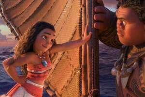 "Moana (voiced by Auli'i Cravalho) and Maui (Dwayne Johnson) go on a mythical journey to save their island in ""Moana."""