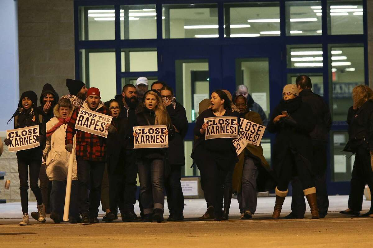 """Members of UltraViolet and GetEQUAL, women and LBBTQ groups, gather in front of the U.S Immigration and Customs Enforcement Karnes County Residential Center to protest allegation of sexual abuse against immigrants at the facility, Thursday, Jan. 22, 2015. The group presented 40,000 petitions calling of the closure of the facility and an investigation into allegations of sexual assaults of women detained at the center. Patrick Fierro, of GetEQUAL Texas said of the detention centers, """"we won't stop until they are all closed."""""""