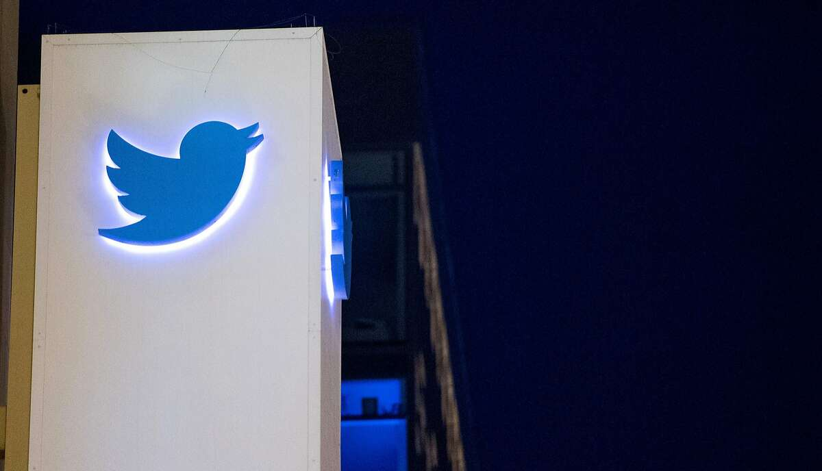 """(FILES) This file photo taken on November 4, 2016 shows the Twitter logo at the company's headquarters in San Francisco, California. Software robots generated a significant number of Twitter messages in support of Donald Trump, distorting the Republican presidential nominee's backing on the social network, a study showed November 7, 2016. The study by University of Southern California computer scientists found that both Trump and Democrat Hillary Clinton had supporting messages from """"bots"""" but that Trump had more bots and produced more tweets. / AFP PHOTO / JOSH EDELSONJOSH EDELSON/AFP/Getty Images"""