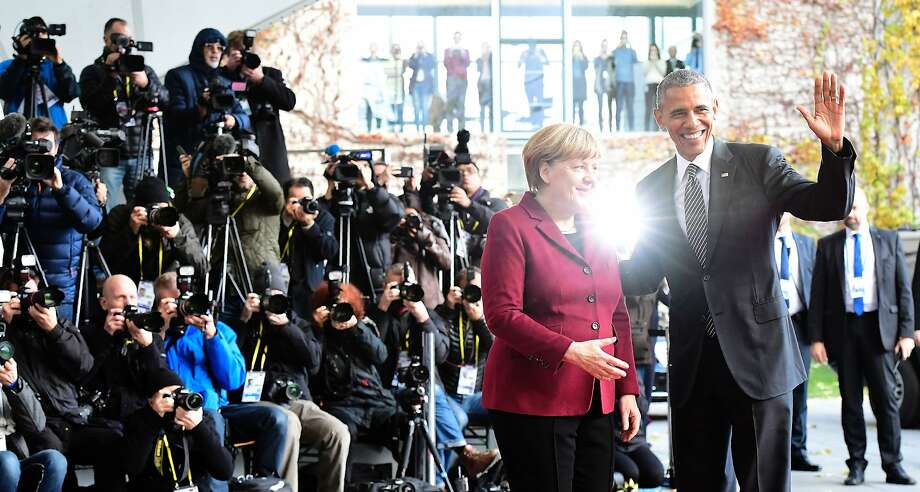 German Chancellor Angela Merkel welcomes President Barack Obama at a meeting of European leaders. Photo: TOBIAS SCHWARZ, AFP/Getty Images