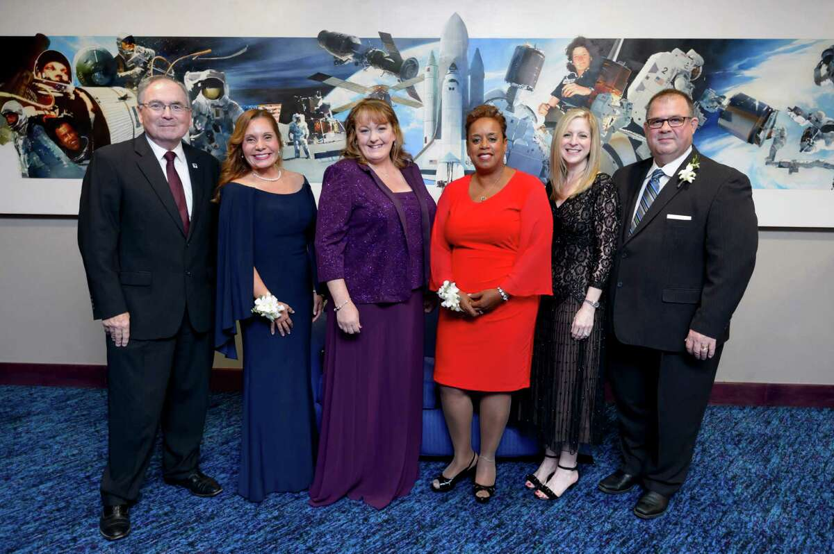 """Four alumni and a university professor were honored Oct. 15 during the University of Houston-Clear Lake's 2016 Alumni Celebration at Space Center Houston. The university hosts the event to recognize the accomplishments and services its alumni and professors provide. Pictured from left, UH-Clear Lake president William A. Staples, League City resident Evelyn Miralles League City (Distinguished Alumna recipient), Pasadena resident Christine """"Christy"""" Harper (Distinguished Alumna recipient), UH-Clear Lake faculty member Lisa A. Jones (Outstanding Professor recipient), Friendswood resident Kristi Knocaba (Early Achievement Award recipient) and Deer Park resident Robert C. Hasson Jr. (Marilyn S. Sims Leadership Service Award recipient)."""