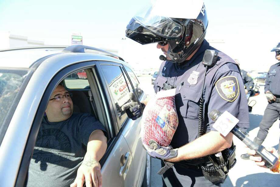Fort Worth Police Department officers gave out turkeys instead of tickets this week. Photo: Fort Worth Police Department
