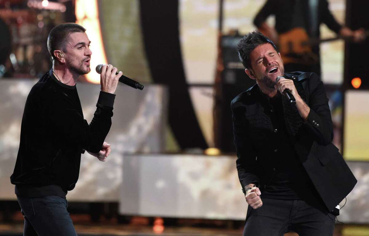 Singer Pablo Lopez (R) and Juanes perform during the show of the 17th Annual Latin Grammy Awards on November 17, 2016, in Las Vegas, Nevada.