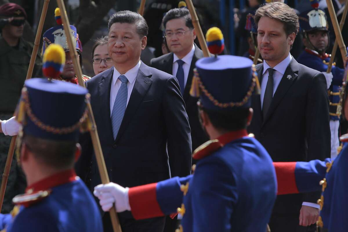 China's President Xi Jinping (L) is accompanied by Ecuador's Foreign Minister Guillaume Long (R) during the wreath laying ceremony at the Monument to the Independence Heroes, during his official visit to Ecuador, in Quito, on November 18, 2016. China's president is set Friday to monitor the opening of a Chinese-built hydroelectric plant in Ecuador on the second day of his visit to the South American country. President Xi Jinping arrived Thursday and met with leftist President Rafael Correa, who has prioritized closer relations with Beijing since coming to power in 2007. / AFP PHOTO / Juan CEVALLOSJUAN CEVALLOS/AFP/Getty Images