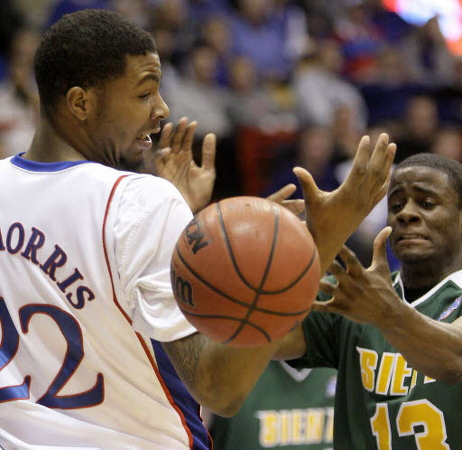 Clarence Jackson, right, had 17 points in 21 minutes in Siena's 91-84 loss at Kansas in 2009. (Associated Press)