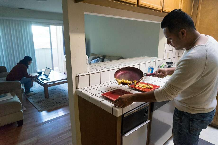 Jose Arias makes breakfast at his home in Redwood City, Calif. on Friday, Nov. 18, 2016. Arias is one of the many people who is concerned that the information he exchanged to be apart of DACA could get him deported. Photo: James Tensuan, Special To The Chronicle