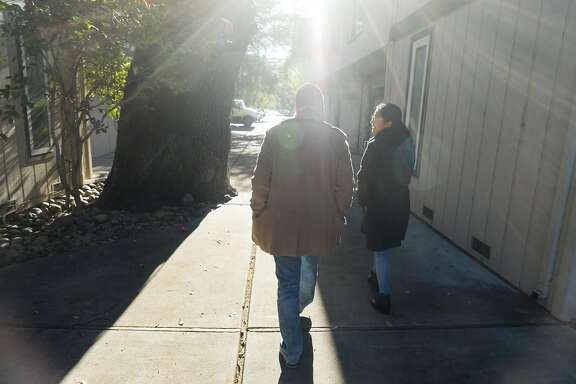 Jose Arias, left, and his girlfriend Crimson Olivares go out for coffee in Redwood City, Calif. on Friday, Nov. 18, 2016. Arias is one of the many people who is concerned that the information he exchanged to be apart of DACA could get him deported.