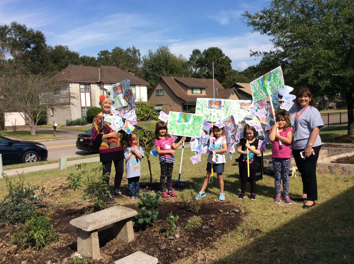 KGC member Nancy Transier, chairman, Arbor Day, young students and Linda Pearce, the principal of Greentree Elementary during the dedication of the butterfly garden.