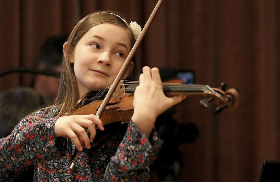 Alma Deutscher plays violin during a rehearsal in Vienna, Austria. Alma Deutscher is a composer, virtuoso pianist and concert violinist who wrote her first sonata at age 6. Photo: Ronald Zak, Associated Press