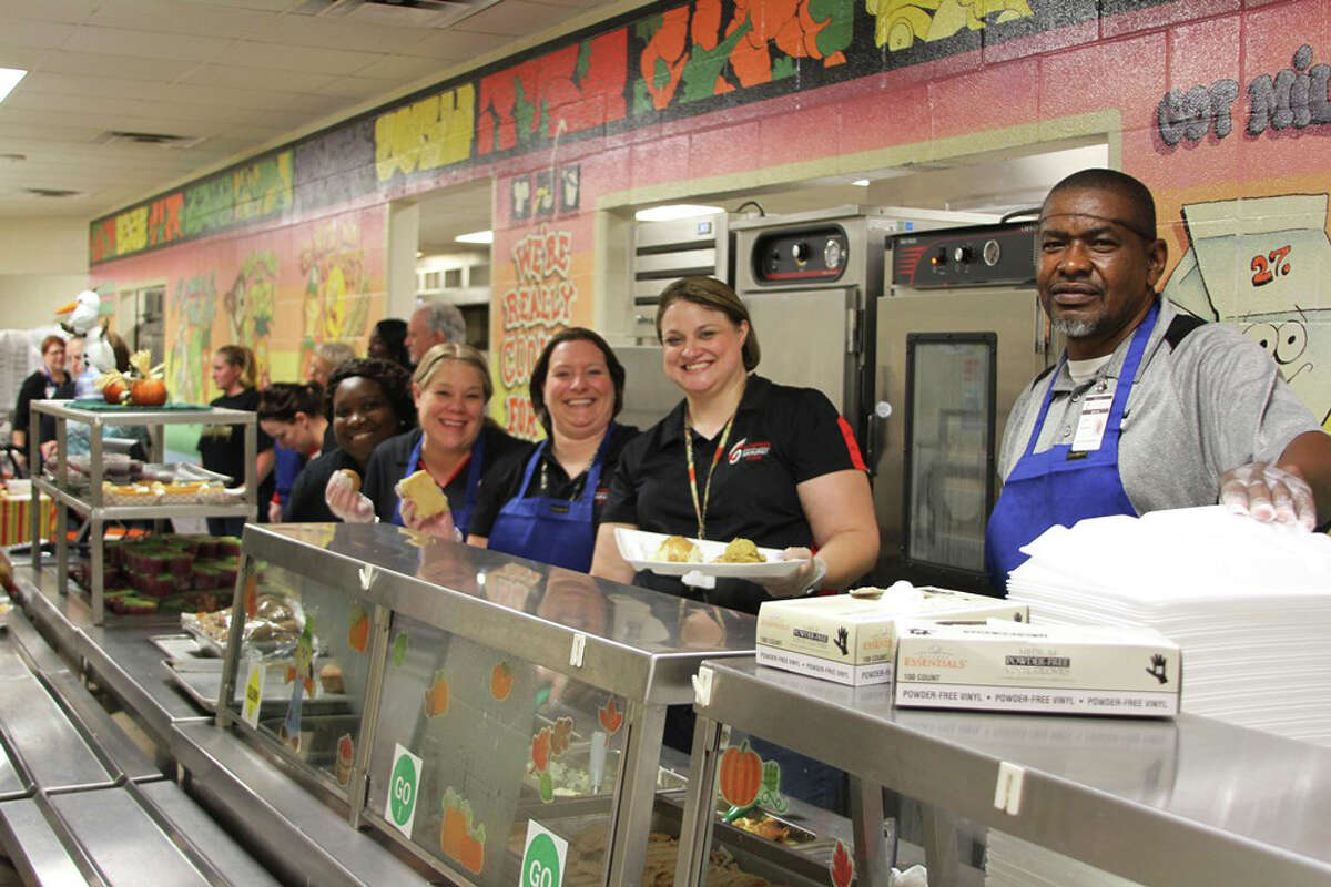 Faculty, staff and administrators pitched in to serve James Street Elementary students and their families at the annual Thanksgiving Luncheon on Thursday, Nov. 10.