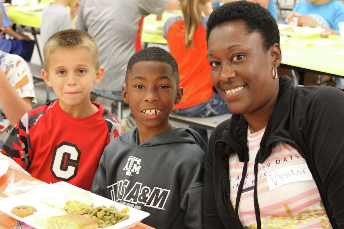 Shwanda Richardson enjoyed a delicious holiday meal with her son Makai Holmes and his friend Rigby Bailes at the James Street Thanksgiving Luncheon on Thursday, Nov. 10