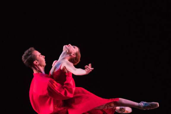 "Ben Needham-Wood lifts Erin Yarbrough-Powell in ""River"" - a new work choreographed by Amy Seiwert for Smuin's annual The Christmas Ballet, playing through Dec. 24 in Walnut Creek, Carmel, Mountain View, and San Francisco. Photo credit: Keith Sutter"