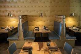 A part of the dining room that features intimate booths and leather lined walls is seen at Bellota, a new Spanish cuisine restaurant in SoMa by the Absinthe Group, in San Francisco, Calif., on Thursday, November 17, 2016. Interior designer Kendall Wilkinson worked on the restaurant's design.